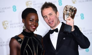 Lupita Nyong'o and and Sam Rockwell with his Bafta for best supporting actor for the film Three Billboards Outside Ebbing, Missouri