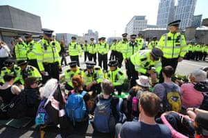 Police talk to protesters on Waterloo Bridge