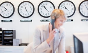 Businesswoman in front of clocks