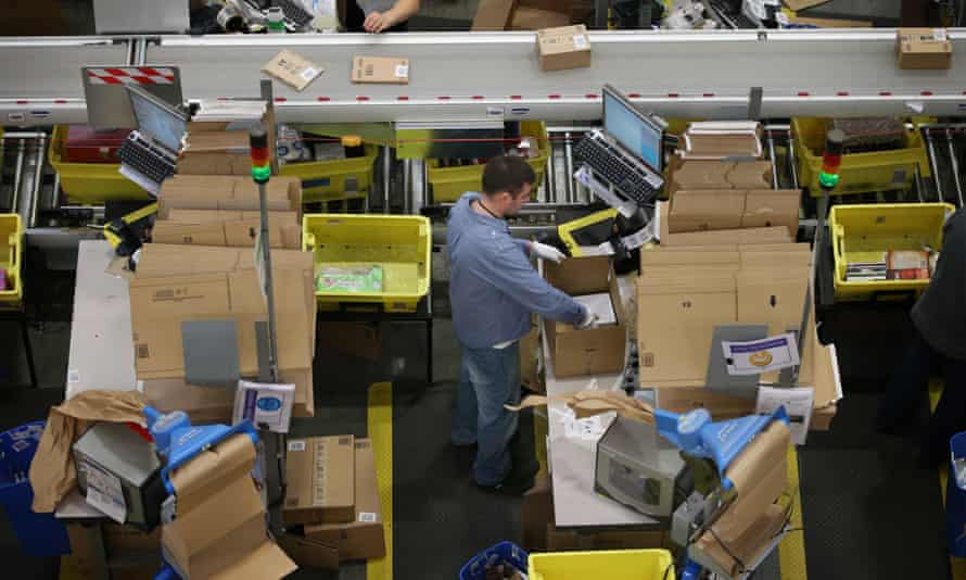 FILE: Workers At Amazon's UK Warehouses Told To Work Overtime To Tackle Huge Demand Due To The Coronavirus Pandemic<br>HEMEL HEMPSTEAD, ENGLAND - DECEMBER 05: Parcels are prepared for dispatch at Amazon's warehouse on December 5, 2014 in Hemel Hempstead, England. In the lead up to Christmas, Amazon is experiencing the busiest time of the year. (Photo by Peter Macdiarmid/Getty Images) FILE: Workers At Amazon's UK Warehouses Told To Work Overtime To Tackle Huge Demand Due To The Coronavirus Pandemic.