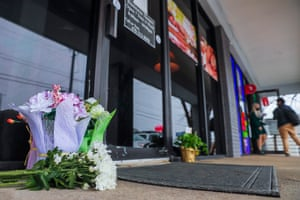 Flowers left by well-wishers sit at the entrance to Young's Asian Spa.