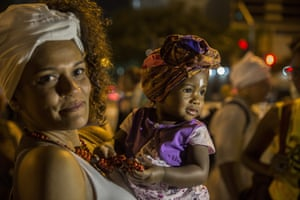 Sao Paulo, Brazil A woman carries a baby during a protest