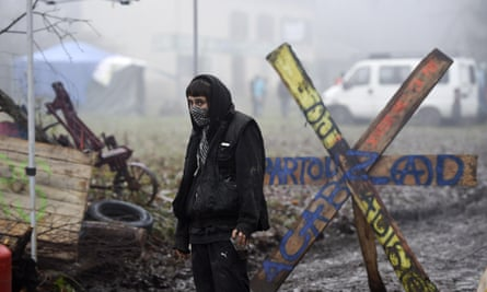 An activist guards a makeshift checkpoint at the protest site in the Chambaran forest in Roybon, France.