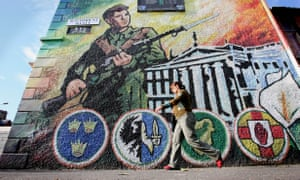 A mural glorifying the IRA on a wall in west Belfast in 2006.