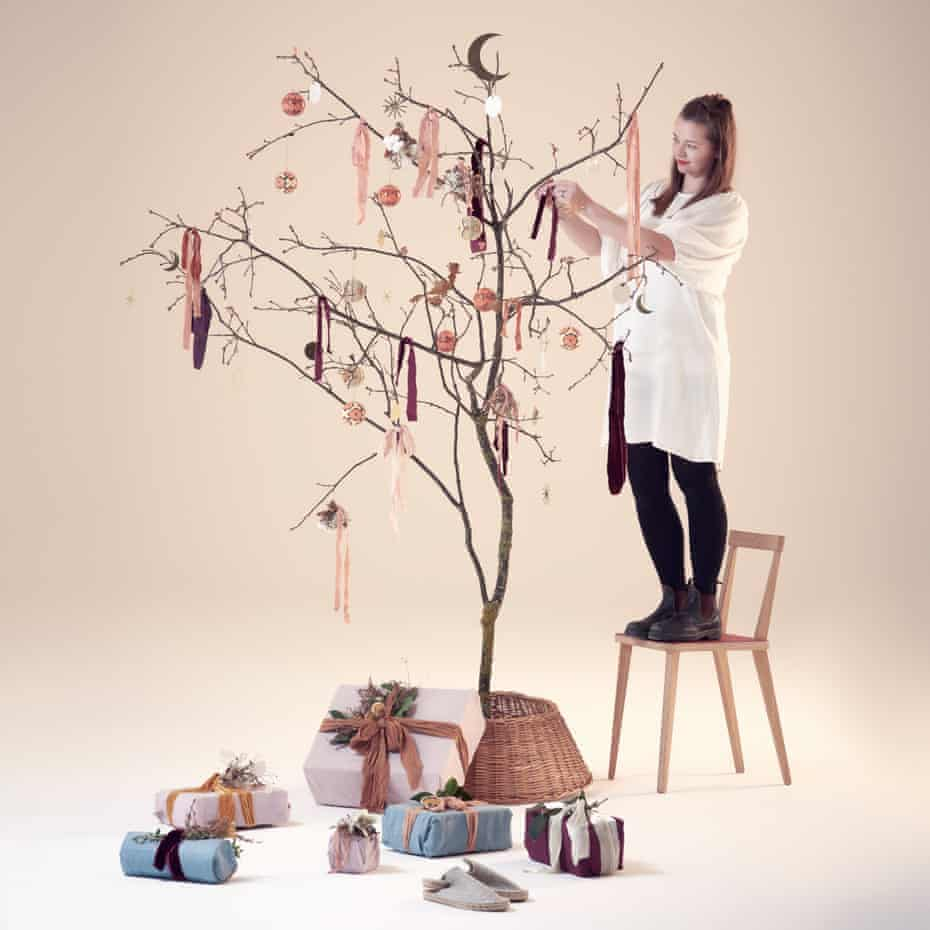 Take a bough: Hannah Bullivant decorates her found branch with papier-mâché baubles by Toast; fabric wrapping by Folds; brass decorations by Workshop Ltd; and ribbons from the Natural Dyeworks. The wicker tree skirt is by Trouva.