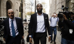 Rapper Meek Mill, center, accompanied by his defense attorney Brian Mcmonagle, arrives at the criminal justice center in Philadelphia this month.