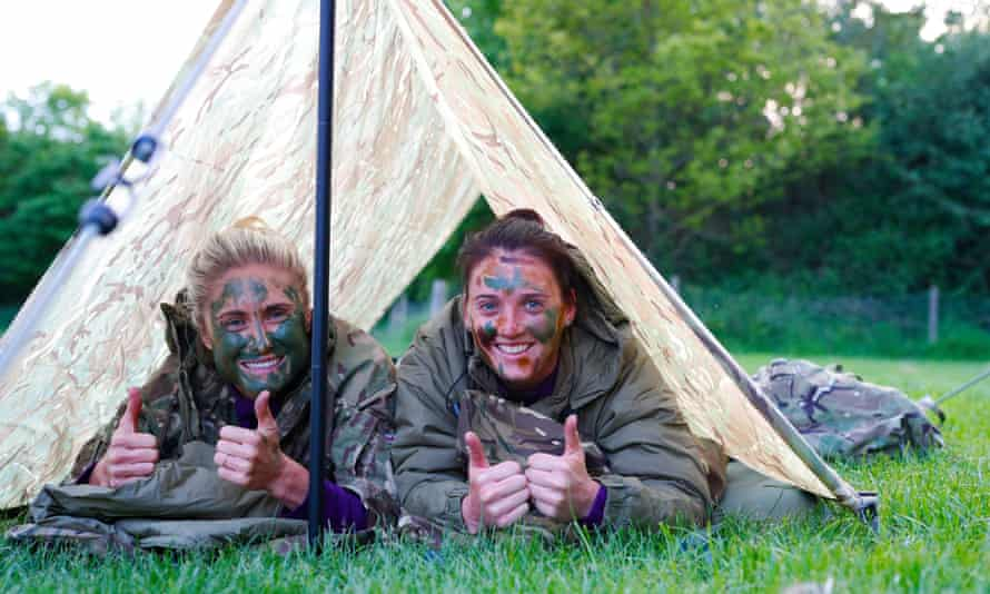 England's Steph Houghton (left) and Jade Moore camped at St George's Park with the rest of the squad and the Royal Marines.