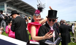 Racegoers react to the race action ... on their phones.