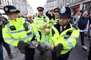 Police officers arrest activists at Oxford Circus