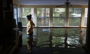 Leslie Andermann Gallagher surveys the flood damage to her home in Sorrento, Louisiana