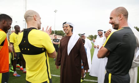 Sheikh Mansour with Pablo Zabaleta and Pep Guardiola at a Manchester City training camp in Abu Dhabi, 2017