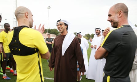 Sheikh Mansour with Manchester City player Pablo Zabaleta and manager Pep Guardiola at a mid-season training camp in Abu Dhabi in February last year