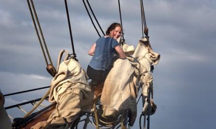 Ship shape: full-time crew member Elin Dieme, 18, tying sails on the bowsprit.