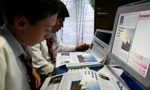 Pupils from Bretton Woods School who won a competition for young book critics, seen producing their own newspaper front pages in The Guardian Newsroom, 60 Farringdon Road, using Apple Macs