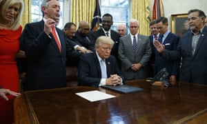 Religious leaders pray with Donald Trump after he signed a proclamation for a national day of prayer.