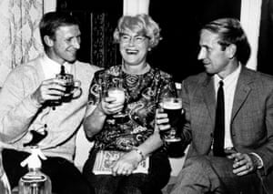Jack (left) and Bobby Charlton enjoy a celebration drink with their mother Cissie after the World Cup semi-final win over Portugal.