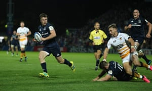 Luke McGrath accelerates to score Leinster's fourth try.