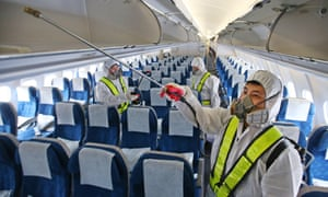 "Workers disinfect a Korean Air aircraft at Incheon international airport. South Korea reported a fourth death from Middle East Respiratory Syndrome prompting Seoul's mayor to declare ""war"" on the virus."