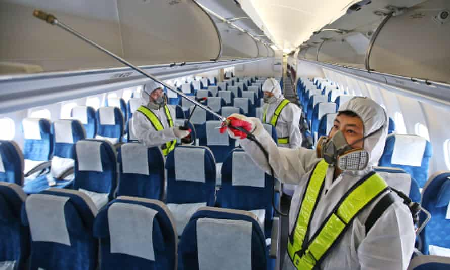 """Workers disinfect a Korean Air aircraft at Incheon international airport. South Korea reported a fourth death from Middle East Respiratory Syndrome prompting Seoul's mayor to declare """"war"""" on the virus."""