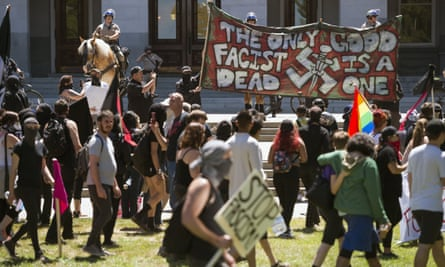 Anti-fascist activists stage a counter-protest against the Traditionalist Worker party and the Golden State Skinheads in June 2016.