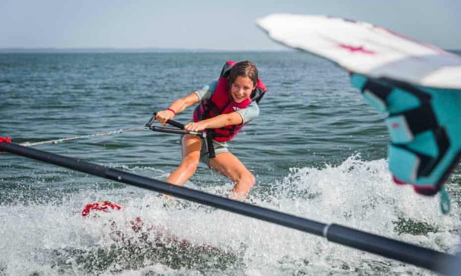 Girl windsurfing at Club Mayotte, Biscarosse France