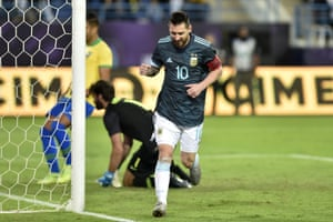 Lionel Messi celebrates after slotting home the rebound having had his penalty saved by Alisson.