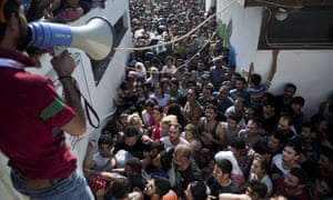 Migrants crammed into Kos stadium