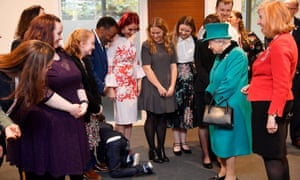Nathan Grant crawls away after being overwhelmed during a visit by the Queen to children's charity Coram.