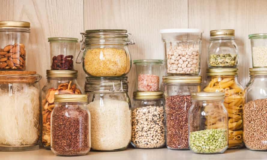 Kitchen shelf full of various cereals and seeds