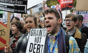 Students rage against tuition fee cuts during a protest outside Downing Street, London.