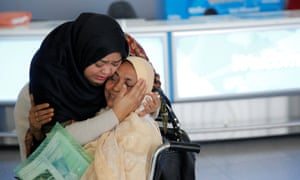 A woman greets her mother after she arrived from Dubai on Emirates flight 203 at John F Kennedy airport in Queens, New York.