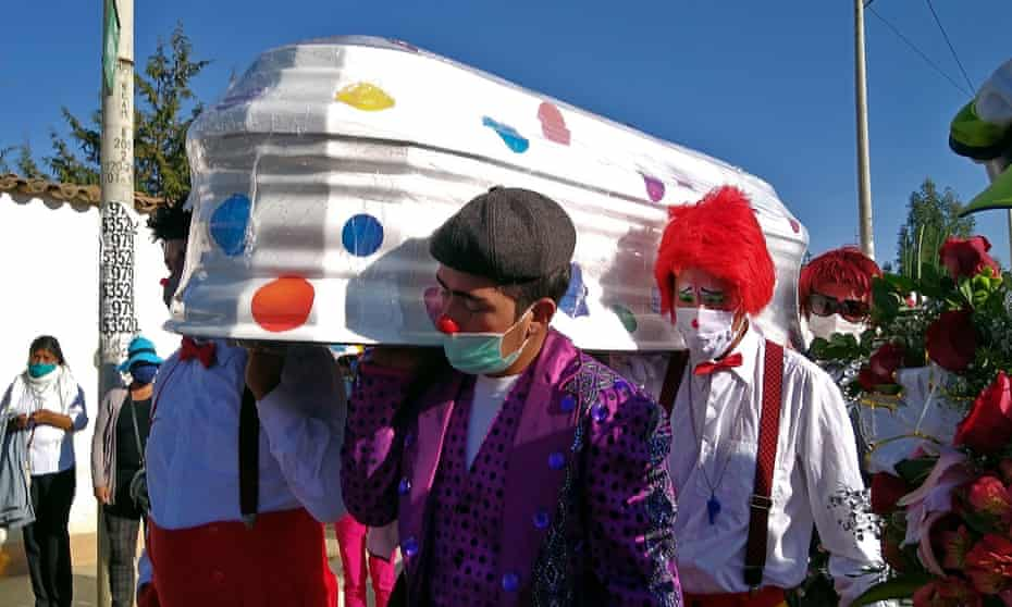 The funeral in Huancayo, Peru, of William Rojas, a clown known as Chupetin, who died of the virus.
