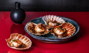 Steamed scallops in the shell.