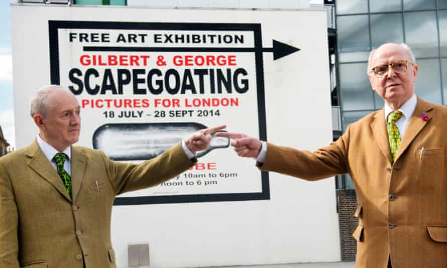Gilbert and George outside their Scapegoating show at the White Cube gallery.