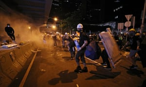 Police clash with protesters outside the Legislative Council building.
