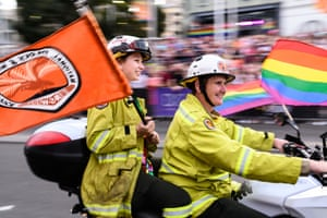 Volunteer firefighters from the National Parks and Wildlife Service ride in the parade