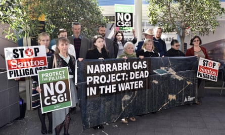 Protesters gather outside the Santos AGM in Adelaide on Thursday.