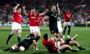 The Lions celebrate as Conor Murray scores their second try.