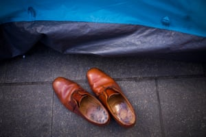 A pair of shoes outside a tent
