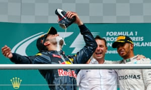 And an unusual drinking recepticle for Red Bull Racing's Daniel Ricciardo as he celebrates with the champagne