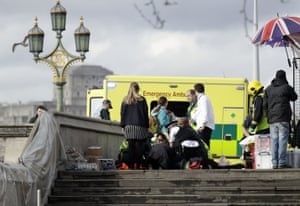 Emergency services staff provide medical attention on Westminster Bridge