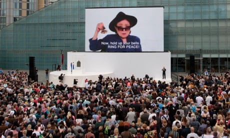 Yoko Ono gets thousands ringing 'bells for peace' in Manchester – video report