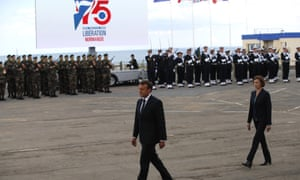 French President Emmanuel Macron, followed by French Defense Minister Florence Parly arrive for a ceremony to pay homage to the Kieffer commando, Thursday, June 6, 2019 in Colleville-Montgomery, Normandy.