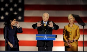 On 4 November 2008, McCain, flanked by running mate Sarah Palin and his wife Cindy, gives his concession speech after losing the presidency to Barack Obama.