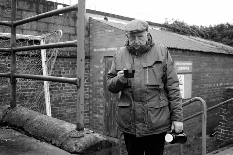 A City supporter with flat cap and flask