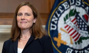 Amy Coney Barrett poses for a photo on Capitol Hill. Progressive activists and analysts are now have begun to cast wary eyes on the unsettling years ahead.