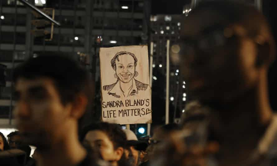 A demonstrator holds a Sandra Bland sign during a vigil in Chicago.
