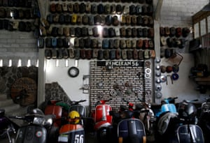 Vespas are displayed in a club and workshop in Kediri,