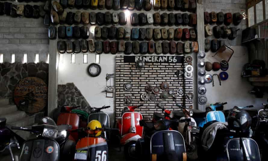 Vespas are displayed in a Vespa club and workshop in Kediri, East Java, Indonesia.