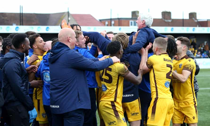 Sutton's kit man, Clive Baxter, who started at the club as a tea boy in 1961 gets the bumps from the team after promotion to League Two was sealed in May.